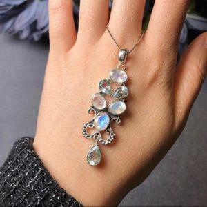Sterling silver moonstone blue topaz pendant